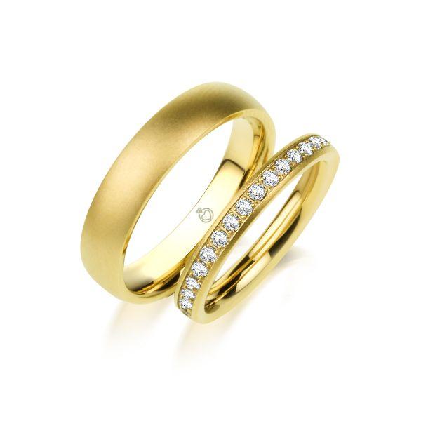 Paar Trauringe/Eheringe einfarbig in Gold oder Platin mit 0.70ct Brillant von Trauringspezialisten.de Modell TS9315