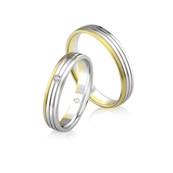 Paar günstige Trauringe/Eheringe schlicht in Gold oder Platin mit 0.02ct Brillant von Trauringspezialisten.de Modell TS9924