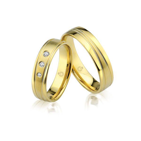 Paar Trauringe/Eheringe einfarbig in Gold oder Platin mit 0.06ct Brillant von Trauringspezialisten.de Modell TS9907